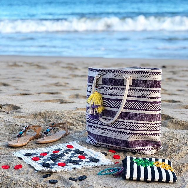 Checkers, Sandals and Bags on the beach